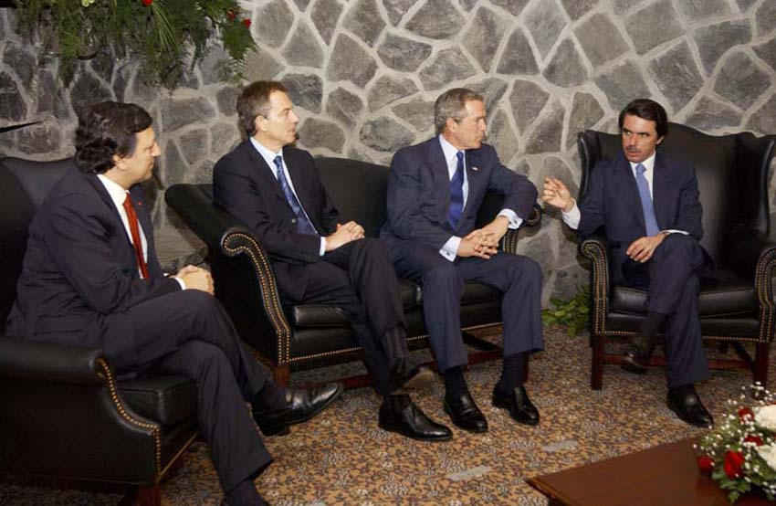 030316-F-1698N-007 Lajes Field, Azores (Mar. 16, 2003) -- President George W. Bush visits the Azores for a one-day emergency summit with Portuguese Prime Minister Jose Manuel Durao Barroso, British Prime Minister Tony Blair, and Spanish Prime Minister Jose Maria Aznar, to discuss the possibilities of war with Iraq.  U.S. Air Force photo courtesy of Staff Sgt. Michelle Michaud.  (RELEASED)